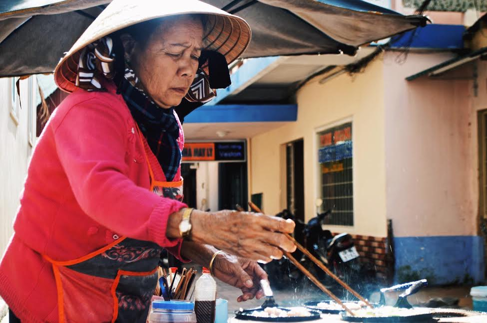 Vietnamese Woman cooking street food