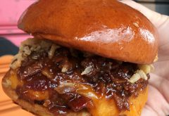 1/2lb Angus beef patty topped with cheddar cheese, bacon jam, applesauce, and crispy onions, served on a warm brioche bun.