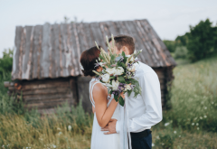 a couple at their diy rustic wedding