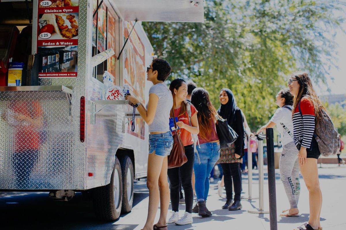 students ordering food from a food truck on campus